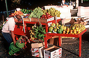 PUERTO RICO, SAN JUAN Old San Juan, fruit stand with bananas, plantains, mango, papaya, grapes, oranges and more