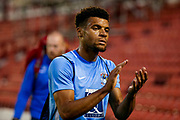 Coventry City forward Maxime Biamou (18) applauds the travelling fans during the Pre-Season Friendly match between Barnsley and Coventry City at Oakwell, Barnsley, England on 18 July 2017. Photo by Simon Davies.