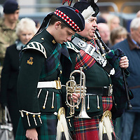 Remembrance Day Wreath Laying Ceremony at the Mercat Cross in Perth...11.11.13<br /> Musician Jordan Currie (left) of the Highland Band Royal Regiment of Scotland observes the two minutes silence alongside Private David Robertson from 7 Scots Royal Regiment of Scotland<br /> Picture by Graeme Hart.<br /> Copyright Perthshire Picture Agency<br /> Tel: 01738 623350  Mobile: 07990 594431