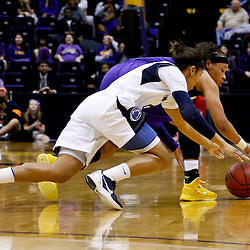 Mar 26, 2013; Baton Rouge, LA, USA; LSU Tigers guard Danielle Ballard (32) and Penn State Lady Lions guard Dara Taylor (2) scramble for a loose ball in the first half during the second round of the 2013 NCAA womens basketball tournament at Pete Maravich Assembly Center. Mandatory Credit: Derick E. Hingle-USA TODAY Sports