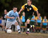 29 Sept. 2011 -- SPANISH LAKE, Mo. -- Trinity Catholic High School soccer player Tom Koerper (7) battles John F. Kennedy Catholic High School's Nick Purcell (13) while wearing a replica jersey from Aquinas High School during alumni night at Trinity in Spanish Lake, Mo. Thursday, Sept. 29, 2011. Trinity was formed in 2003, and alumni from the 16 state title winning boys' soccer teams from predecessor schools Rosary, Aquinas and Aquinas-Mercy were honored at the game. Photo © copyright 2011 Sid Hastings.