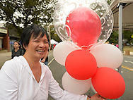 Merrick, New York, USA. 13th September 2014. Merrick Store owner Jan displays her decorative red and white balloons at the 23rd Annual Merrick Fall Festival & Street Fair in suburban Long Island.