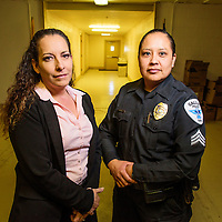 Detective sargent Rosanne Kauzlarich, left, and sargent Melanie Begay pose for a portrait together at the Gallup Police Department Wednesday.