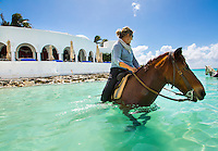 Rendezvous Bay, Anguilla - January 07, 2015: Visitors ride horses along the tranquil shores of Rendezvous Bay to Cap Juluca resort courtesy of Seaside Stables. For those who are looking for more adventure, Seaside Stables allows riders to take the horses into the water for a fee. CREDIT: Chris Carmichael for The New York Times