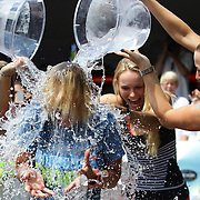 Tournament Director Anne Worcester takes the ALS Ice Bucket Challenge with the help of Tennis players Simona Halep, (left), Caroline Wozniack, (centre), and Petra Kvitova, (right), during the Connecticut Open at the Connecticut Tennis Center at Yale, New Haven, Connecticut, USA. 17th August 2014. Photo Tim Clayton