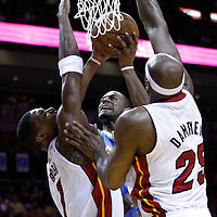 19 March 2011: Denver Nuggets shooting guard Arron Afflalo (6) goes for the layup between Miami Heat power forward Chris Bosh (1) and Miami Heat center Erick Dampier (25) during the Miami Heat 103-98 victory over the Denver Nuggets at the AmericanAirlines Arena, Miami, Florida, USA.
