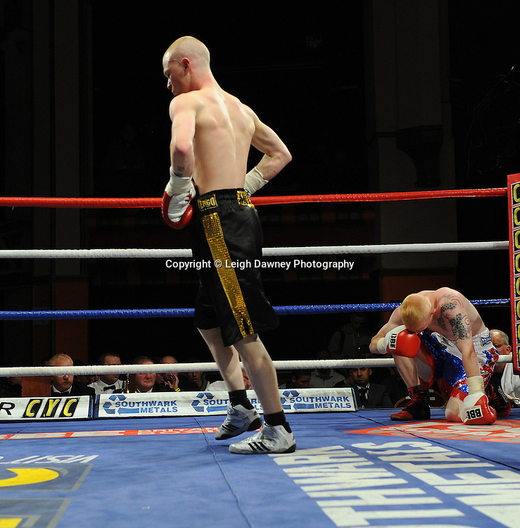 Anthony Smith (black/gold shorts & pro debut fight) defeats Kevin Coglan in a 4 x 3 min round Flyweight contest at Olympia, Liverpool on the 11th June 2011. Frank Maloney Promotions.Photo credit: Leigh Dawney 2011