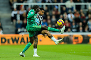 Abdoulaye Doucoure (#16) of Watford contests the ball with Kenedy (#15) of Newcastle United during the Premier League match between Newcastle United and Watford at St. James's Park, Newcastle, England on 3 November 2018.