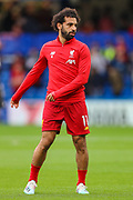 Liverpool forward Mohamed Salah (11) warms up prior to the Premier League match between Chelsea and Liverpool at Stamford Bridge, London, England on 22 September 2019.