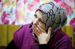 Syrian refugee Ibtissam Bathish Mtaweh, 43, who lives with her husband and four children in the basement of a former ski chalet block in Mount Lebanon, just north of the Lebanese capital, after the family fled Syria five years ago.