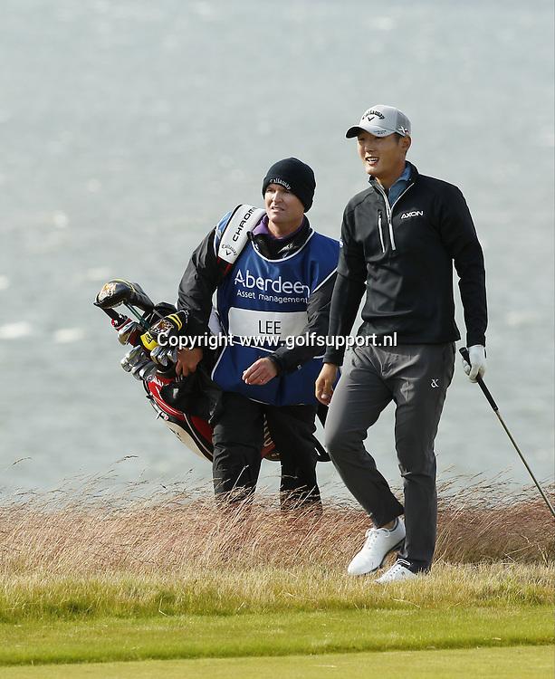 07-07-16 European Tour 2016, Aberdeen Asset Management Scottish Open, Castle Stuart Golf Links, Inverness, Scotland, UK. 07 - 10 Jul. Danny  Lee of New Zealand with caddie during the first round.