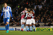 Aston Villa defender Nathan Baker (2) is mobbed after his goal to make it 1-0 during the EFL Sky Bet Championship match between Brighton and Hove Albion and Aston Villa at the American Express Community Stadium, Brighton and Hove, England on 18 November 2016. Photo by Bennett Dean.