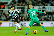 Ki Sung-Yueng (#4) of Newcastle United plays a short range pass beyond Will Hughes (#19) of Watford during the Premier League match between Newcastle United and Watford at St. James's Park, Newcastle, England on 3 November 2018.