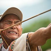Bunun tribesman shoots an arrow, Annual Bunun Ear Festival, Maya village, Ming Chuan, Namasiya Township, Kaoshiung County, Taiwan