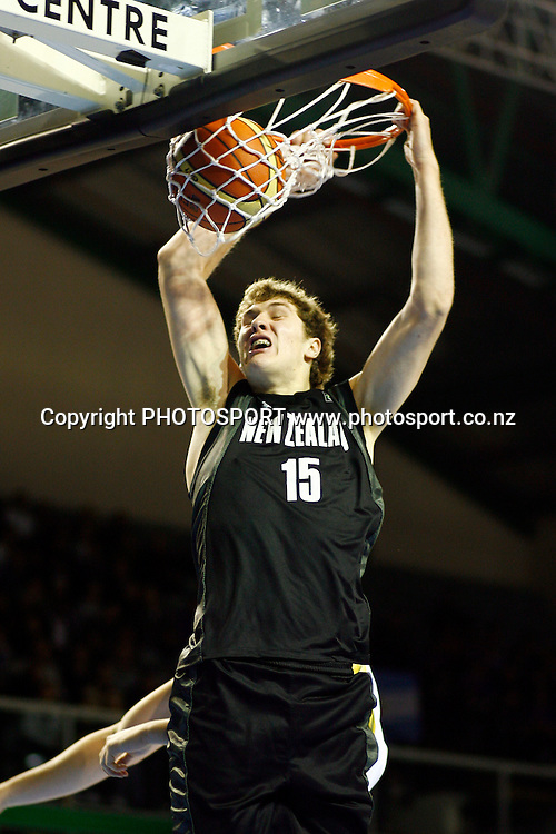 New Zealand's Rob Loe with a dunk. U19 Basketball World Championship, New Zealand v Argentina ,North Shore Events Centre, Auckland. 2 July 2009. Photo: Anthony Au-Yeung/PHOTOSPORT
