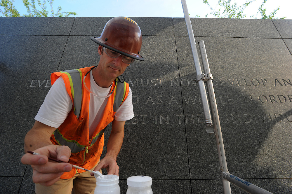 WASHINGTON (May 26, 2007) -- Third-generation stone carver 46-year-old Nicholas Benson of Newport, R.I., engraves more than a dozen quotations from the Rev. Martin Luther King Jr. into the memorial that will honor the slain civil rights leader. To commemorate the life and work of Dr. Martin Luther King, Jr., the creation of a memorial to honor his national and international contributions to world peace through non-violent social change is happening in Washington, DC.  Located in West Potomac Park, the Martin Luther King, Jr. National Memorial looks to perform an official dedication on Sunday, August 28, 2011, the 48th anniversary of the March on Washington and Dr. King's historic I Have A Dream speech.  Photo by Johnny Bivera