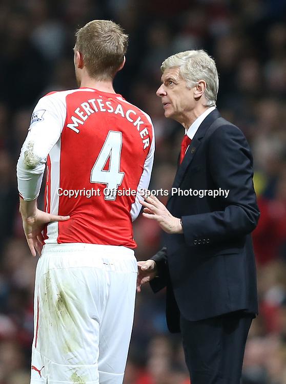 22 November 2014 - Barclays Premier League - Arsenal v Manchester United - Arsene Wenger, Manager of Arsenal speaks with Per Mertesacker - Photo: Marc Atkins / Offside.