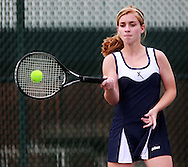 Xavier's Elizabeth Hoffmann returns the ball to Prairie's Caroline Rainey (not pictured) during their match in the 1st round of the Regional Tennis Tournament at Xavier High School in Cedar Rapids on Saturday, May 15, 2010. Hoffmann defeated Rainey 6-0, 6-0 and Xavier defeated Prairie 5-0.