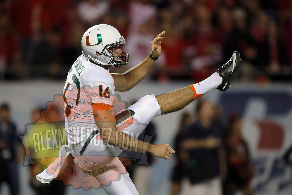 Miami Hurricanes punter Pat O'Donnell (16) kicks the ball during the NCAA Football Russell Athletic Bowl football game between the Louisville Cardinals and the Miami Hurricanes, at the Florida Citrus Bowl on Saturday, December 28, 2013 in Orlando, Florida. Louisville won the game by a score of 36-9. (AP Photo/Alex Menendez)