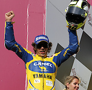 Victorious Valentino Rossi wins the Commercial Bank Grand Prix of Qatar, MOTO GP class, Losail International Circuit, 8 April 2006