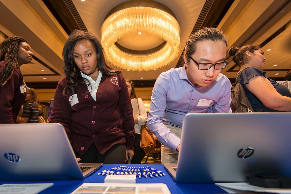 Houston ISD recruiters work at a teacher job fair at the University of Houston, April 7, 2017.
