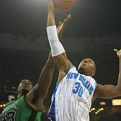 11 February 2009:  New Orleans Hornets forward David West (30) grabs a rebound over Boston Celtics center Kendrick Perkins (43) during a NBA game between the Boston Celtics and the New Orleans Hornets at the New Orleans Arena in New Orleans, LA.