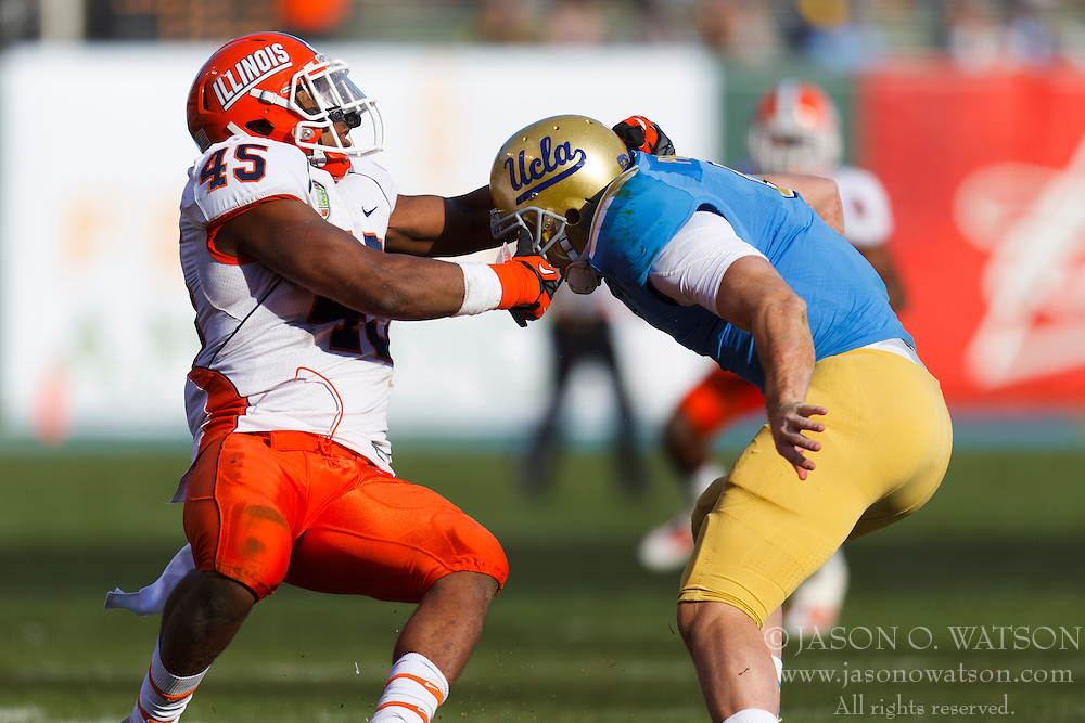 Dec 31, 2011; San Francisco CA, USA; UCLA Bruins quarterback Kevin Prince (right) breaks a tackle from Illinois Fighting Illini linebacker Jonathan Brown (45) during the second quarter at AT&T Park. Illinois defeated UCLA 20-14. Mandatory Credit: Jason O. Watson-US PRESSWIRE