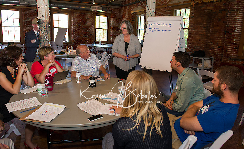 Gerald Knight starts a discussion with Robin LeBlanc of Plan NH during Friday afternoon's charrette with Re-Imagine Laconia at the Belknap Mill.  (Karen Bobotas/for the Laconia Daily Sun)