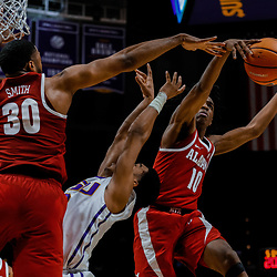 Jan 13, 2018; Baton Rouge, LA, USA; Alabama Crimson Tide forward Galin Smith (30) blocks a shot by LSU Tigers guard Tremont Waters (3) as guard Herb Jones (10) defends the play during the second half at the Pete Maravich Assembly Center. Alabama defeated LSU 74-66.  Mandatory Credit: Derick E. Hingle-USA TODAY Sports