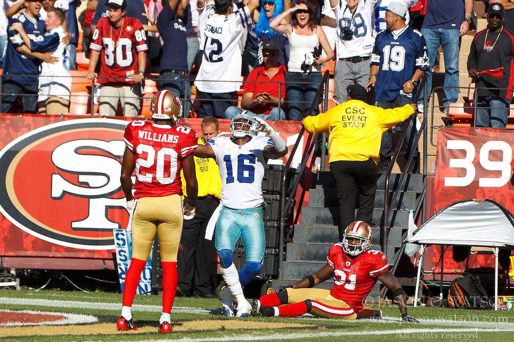 September 18, 2011; San Francisco, CA, USA;  Dallas Cowboys wide receiver Jesse Holley (16) celebrates in front of San Francisco 49ers free safety Madieu Williams (20) and strong safety Donte Whitner (31) after a 77 yard pass reception during the overtime at Candlestick Park.  Dallas defeated San Francisco 27-24 in overtime.