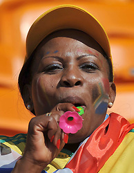 JOHANNESBURG, SOUTH AFRICA - Friday, June 11, 2010: A South Africa supporter blowing a vuvuzela, a noisy horn, during the opening Group A match against Mexico during the 2010 FIFA World Cup South Africa at the Soccer City Stadium. (Pic by Hoch Zwei/Propaganda)