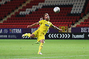 AFC Wimbledon midfielder Scott Wagstaff (7) lining up a volley during the EFL Trophy match between Charlton Athletic and AFC Wimbledon at The Valley, London, England on 4 September 2018.