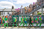 "UNITED KINGDOM, London: 16 May 2015 Rugby fans arrive at Twickenham train station in fancy dress for the Marriott London Sevens Rugby tournament. More than 113,000 fans, most of them in fancy dress, will ascend onto Twickenham for the sporting entertainment. This years fancy dress theme was ""Space"". Rick Findler / Story Picture Agency"