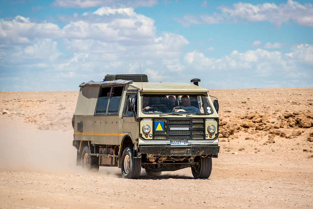 A desert vehicle makes it was through the Namib desert in Namibia, Africa.