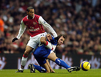 Photo: Olly Greenwood.<br />Arsenal v Blackburn Rovers. The Barclays Premiership. 23/12/2006. Arsenal's Gael Clichy tackled by Blackburn's Lucas Neil