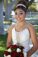 Portrait of young bride outdoors