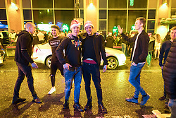 "© Licensed to London News Pictures . 23/12/2017. Manchester, UK. Revellers outside the Printworks in Manchester City Centre overnight during "" Mad Friday "" , named for being one of the busiest nights of the year for the emergency services in the UK . Photo credit: Joel Goodman/LNP"