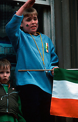 IRELAND DUBLIN 17MAR00 - A young boy salutes towards the carnival crowd while holding an Irish Republican flag during St. Patrick's Day celebrations in Dublin...jre/Photo by Jiri Rezac..© Jiri Rezac 2000..Contact: +44 (0) 7050 110 417.Mobile:  +44 (0) 7801 337 683.Office:  +44 (0) 20 8968 9635..Email:   jiri@jirirezac.com.Web:     www.jirirezac.com..© All images Jiri Rezac 2000 - All rights reserved.