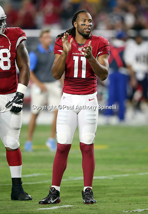 Arizona Cardinals wide receiver Larry Fitzgerald (11) claps for his teammates during player introductions before the 2015 NFL preseason football game against the San Diego Chargers on Saturday, Aug. 22, 2015 in Glendale, Ariz. The Chargers won the game 22-19. (©Paul Anthony Spinelli)