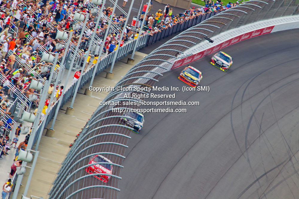 17 June 2012: Tony Stewart, driver of the Mobil 1/Office Depot #14 Chevrolet, leads the field after a restart through turn four during the NASCAR Sprint Cup Series Quicken Loans 400 at Michigan International Speedway in Brooklyn, MI.