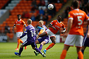 Sullay Kaikai of Blackpool  and Andy Cannon of Portsmouth during the EFL Sky Bet League 1 match between Blackpool and Portsmouth at Bloomfield Road, Blackpool, England on 31 August 2019.