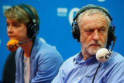 © Licensed to London News Pictures. 25/08/2015. Stevenage, UK. Labour Party leader candidates Yvette Cooper and Jeremy Corbyn taking part at a husting for Radio 5 at Stevenage Arts & Leisure Centre in Stevenage on Tuesday, 25 August 2015. Photo credit: Tolga Akmen/LNP