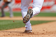 June 3, 2010: Detroit Tigers' Carlos Guillen (9) runs to second in this close up of his cleats during the MLB baseball game between the Cleveland Indians and Detroit Tigers at  Comerica Park in Detroit, Michigan.