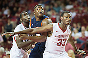 FAYETTEVILLE, AR - DECEMBER 19:  Moses Kingsley #33 of the Arkansas Razorbacks blocks out Myles Taylor #33 of the UT Martin Skyhawks at Bud Walton Arena on December 19, 2013 in Fayetteville, Arkansas.  The Razorbacks defeated the Skyhawks 102-56.  (Photo by Wesley Hitt/Getty Images) *** Local Caption *** Moses Kingsley; Myles Taylor