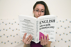 Polish student studying an English language book,