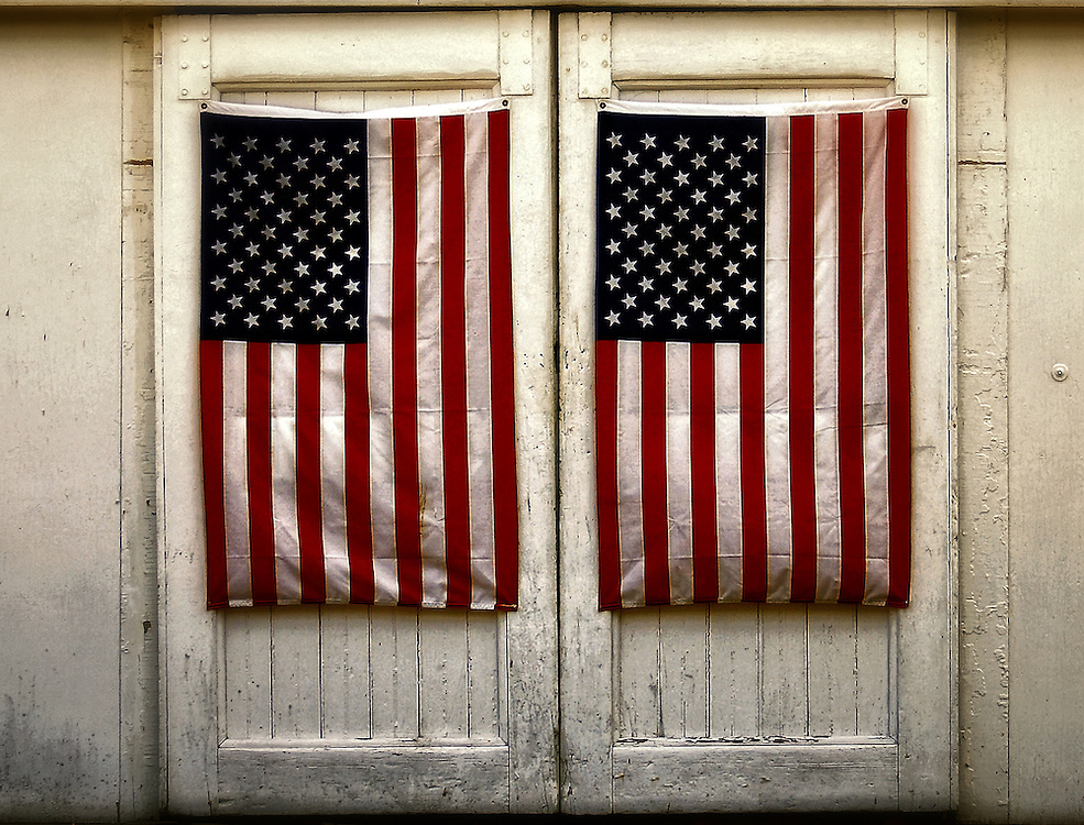Amnerican flags cover the barn doors at Fitts Mill in Scituate, Massachusetts.