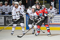KELOWNA, CANADA, NOVEMBER 9: Mathew Dumba #24 of the Red Deer Rebels and Colton Sissons #15 of the Kelowna Rockets look for the pass as the Red Deer Rebels visit the Kelowna Rockets  on November 9, 2011 at Prospera Place in Kelowna, British Columbia, Canada (Photo by Marissa Baecker/Shoot the Breeze) *** Local Caption ***