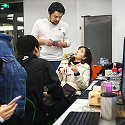 Nai Nai, a 23-year-old live-streamer in Shanghai, China, talks with her boss Borix Xu. 