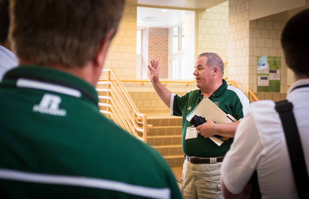 Master's in Athletic Administration faculty member John Evers leads MAA students through the PIng Center during a walking tour of campus on Friday, June 26, 2015. © Ohio University / Photo by Rob Hardin