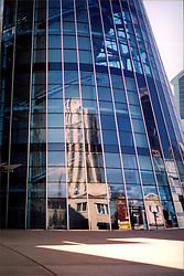 2001 September:  Downtown Nashville skyline reflecting in the windows of the Gaylord Building..This image was scanned from a print.  Image quality may vary.  Dust and other unwanted artifacts may exist.